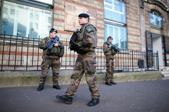 """French soldiers secure the access to a Jewish school in Paris as part of the highest level of """"Vigipirate"""" security plan"""