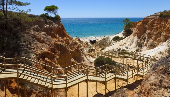 portugal wooden staircase to beach Algarve